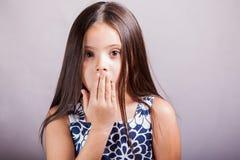 Pretty little girl gossiping Royalty Free Stock Photo