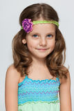 Pretty little girl on the grey background Royalty Free Stock Photography