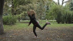 Pretty little girl has fun in the park stock video footage