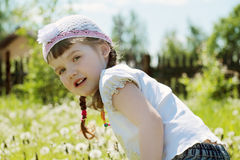 Pretty little girl in hat looks at camera Royalty Free Stock Photography