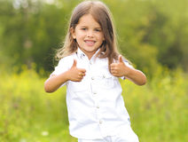 Pretty little girl having fun. Show gesture ok Royalty Free Stock Images