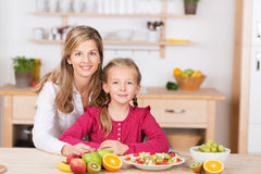 Pretty little girl helping prepare a fruit salad Royalty Free Stock Images