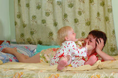 Pretty little girl and her mother playing. Stock Photo