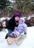 Pretty little girl with her mother on winter Stock Photos