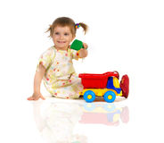Pretty little girl and her toys Stock Photography