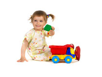 Pretty little girl and her toys Stock Image