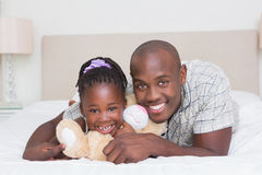 Pretty little girl with his father in bed Royalty Free Stock Photography