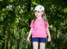 Pretty little girl holding brushwood Royalty Free Stock Image