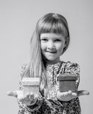 Pretty little girl holding a gift boxes Royalty Free Stock Photography