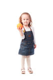Pretty little girl holding an orange isolated on white. Background Stock Photos