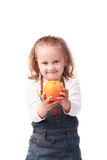 Pretty little girl holding an orange isolated on white Stock Images