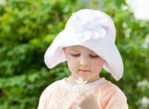 Pretty little girl holding summer flower Royalty Free Stock Photo