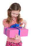 Pretty little girl holds a gift box Stock Photos