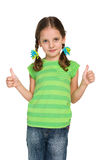 Pretty little girl holds her thumbs up Stock Photos