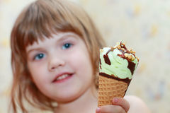 Pretty little girl holds ice cream Royalty Free Stock Photos