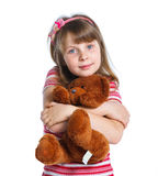 Young girl with bear on white... Royalty Free Stock Photos