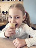Pretty  little girl with ice-cream Stock Photography