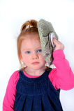 Pretty little girl with ice on head. Little redhead girl with blue eyes with ice pack on head Royalty Free Stock Photos