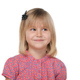 Pretty little girl imagines. A pretty little girl imagines against the white background royalty free stock images