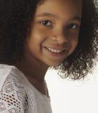 Pretty little girl isolated against white backgrou Stock Photo