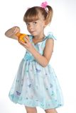 Pretty little girl with a juicy pear Royalty Free Stock Photos