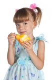 Pretty little girl with a juicy pear Royalty Free Stock Image