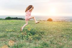 Pretty little girl jumping outdoors Royalty Free Stock Image