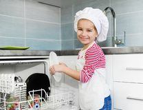 Little girl on the kitchen Royalty Free Stock Photos