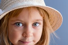 Pretty little girl with large green eyes royalty free stock images