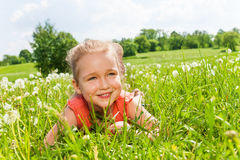 Pretty little girl laying on the grass Royalty Free Stock Image