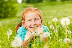 Pretty little girl lays on a grass Stock Images