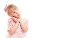 Pretty little girl leaning her head on hands Stock Images