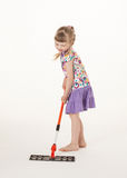 Pretty little girl learning to hold a swab Royalty Free Stock Photography