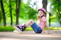 Pretty little girl learning to roller skate  outdoors Stock Photography