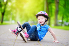 Pretty little girl learning to skateboard outdoors Stock Photography