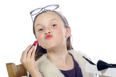 A pretty little girl with lipstick Royalty Free Stock Photo