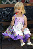 Pretty little girl with lollipop stock image
