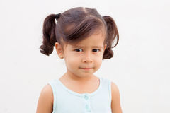 Pretty little girl looking at camera outdoor Royalty Free Stock Images