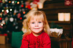 Pretty little girl looking into the camera over background with Stock Photography