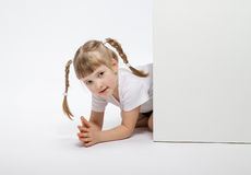Pretty little girl looking  out of the door Royalty Free Stock Photos