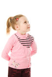 Pretty little girl looking to the side and up. On a white background Stock Photos