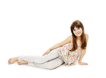 Pretty little girl lying on the floor in jeans. Isolated on white background stock photos