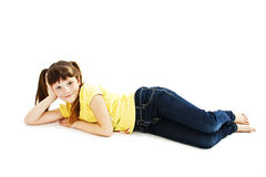 Pretty little girl lying on the floor in jeans Stock Photos
