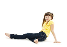 Pretty little girl lying on the floor in jeans Royalty Free Stock Photos