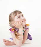 Pretty little girl lying on the floor and thinking Royalty Free Stock Photo