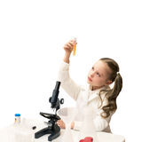 Pretty little girl is making science experiments and playing wit Stock Photo