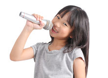 Pretty little girl with the microphone in her hand. On white background Royalty Free Stock Photography