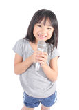 Pretty little girl with the microphone in her hand. On white background Royalty Free Stock Photos