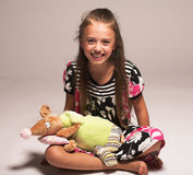 Pretty little girl with mouse. Studio shot Stock Photography