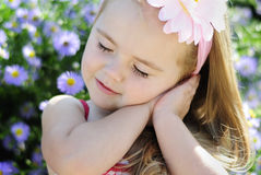 Pretty little girl near colors Stock Image